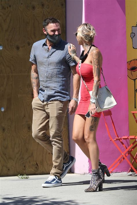 Brian Austin Green and Tina Louise Show Some PDA During